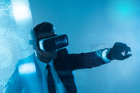 businessman in virtual reality headset isolated on blue, artificial intelligence concept