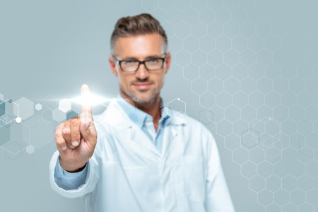 selective focus of handsome scientist touching interface in air isolated on white, artificial intelligence concept
