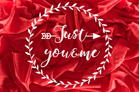 beautiful red silk fabric with just you and me lettering, valentines day background