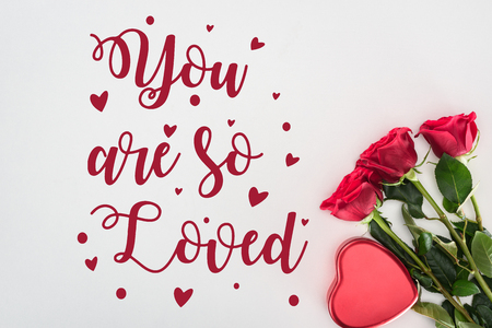 beautiful decorative red heart and tender rose flowers isolated on grey background with you are so loved lettering, valentines day concept
