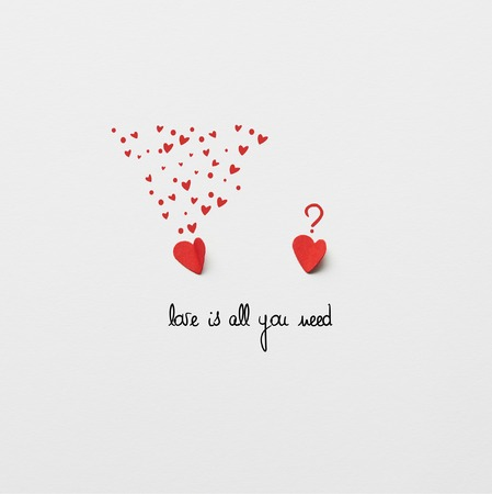 top view of two red paper cut hearts on white background with Love is all you need lettering Reklamní fotografie