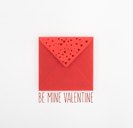 flat lay with red envelope isolated on white, st valentine day concept with be mine valentine lettering Zdjęcie Seryjne