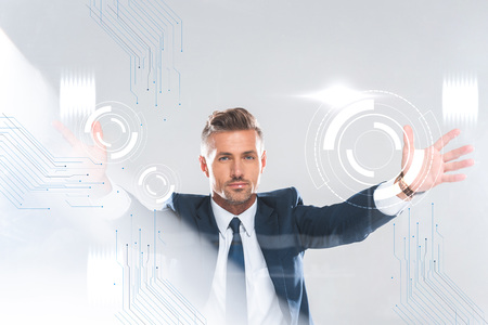 handsome businessman holding innovation technology isolated on white, artificial intelligence concept
