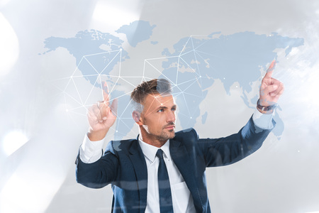 handsome businessman moving innovation technology with world map isolated on white, artificial intelligence concept