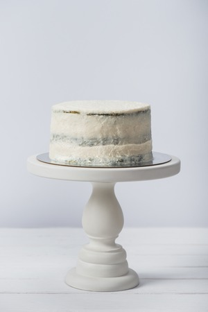 creamy cake on tray isolated on white Stock Photo
