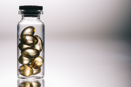 medical pills with transparent shell in bottle on grey background Stock Photo - 117877798