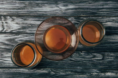top view of bottled organic tea on wooden table Stock Photo