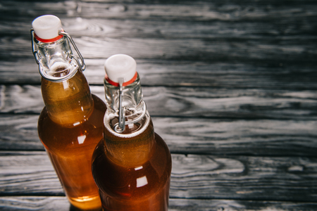 studio shot of fermented tea in glass bottles with sunlight