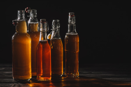 homemade traditional tea in glass bottles isolated on black 版權商用圖片 - 117894008
