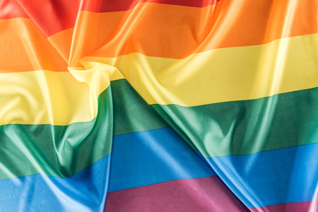 top view of creased rainbow flag, lgbt concept