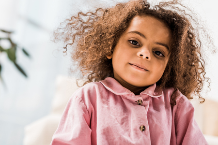 beautiful curly african american child looking at camera and smiling Stock fotó
