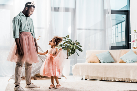 happy african american father looking at cute daughter in beautiful dress Foto de archivo - 117908661