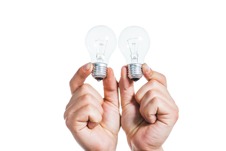 cropped view of led lamps in hands of man isolated on white, energy efficiency concept