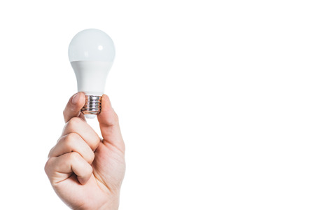 cropped view of man holding fluorescent lamp isolated on white, energy efficiency concept