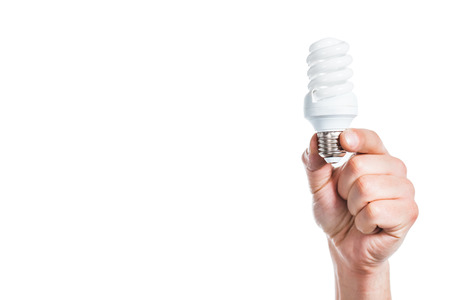 cropped view of fluorescent lamp in male hand isolated on white, energy efficiency concept Stock Photo