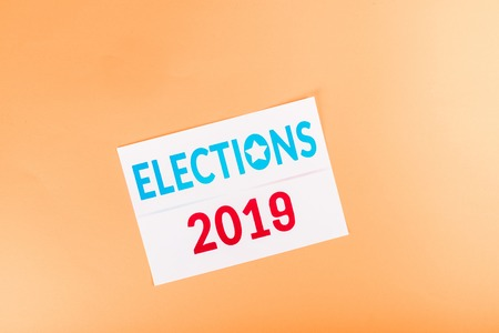top view of card with elections 2019 lettering isolated on orange