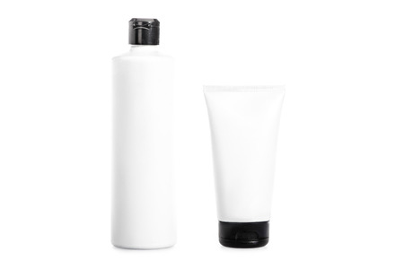 Studio shot of cream tube and bottle of hair conditioner isolated on white