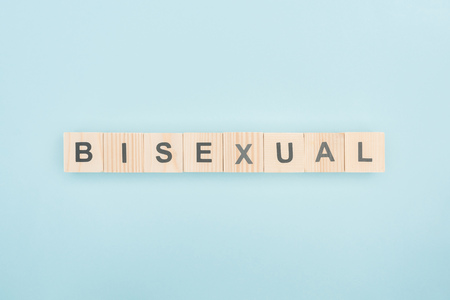 top view of bisexual lettering made of wooden cubes on blue background Stock Photo