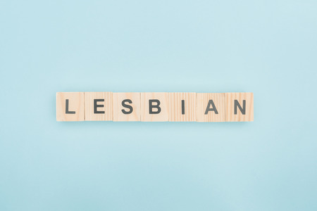top view of lesbian lettering made of wooden cubes on blue background