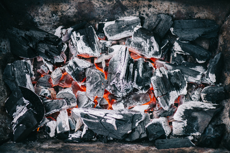 top view of hot burning coals with ash in fireplace Фото со стока