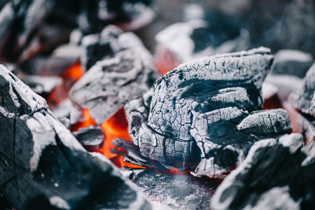 selective focus of hot burning coals in ash 写真素材