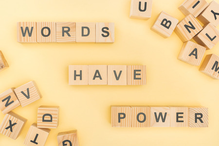 top view of phrase words have power lettering with wooden cubes on yellow background Reklamní fotografie