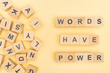 top view of phrase words have power lettering with wooden cubes on yellow background Фото со стока
