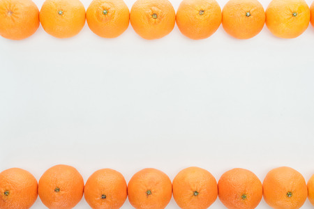frame borders of ripe orange tangerines on white background with copy space Stock Photo