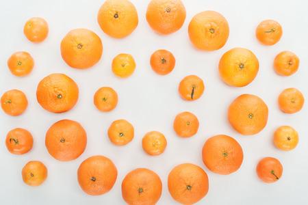 flat lay with ripe bright orange tangerines on white background