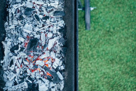 top view of barbecue with burning hot coals and ash