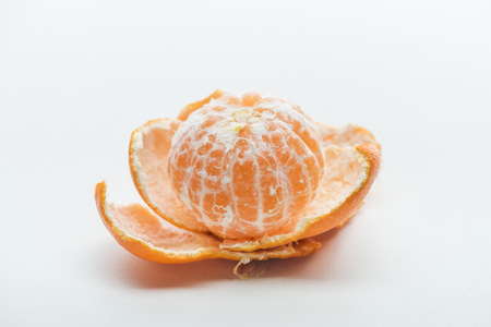 ripe juicy orange whole peeled tangerine with peel on white background Stock Photo