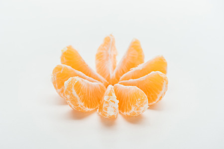 ripe orange tangerine slices arranged in circle on white background Stock Photo