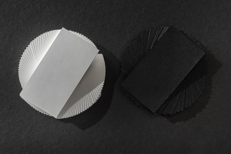 top view of empty cards on black table with copy space