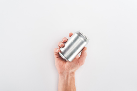 Cropped view of man holding empty can on grey background