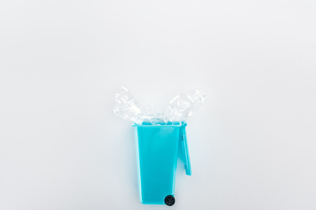 Top view of blue toy trashcan and empty plastic bottle 스톡 콘텐츠