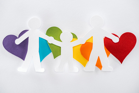 paper cut family and rainbow multicolored paper hearts on grey background, lgbt concept Stock Photo