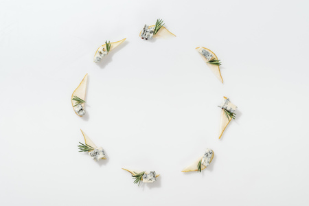 top view of sliced pears with blue cheese and rosemary twigs on white background 写真素材