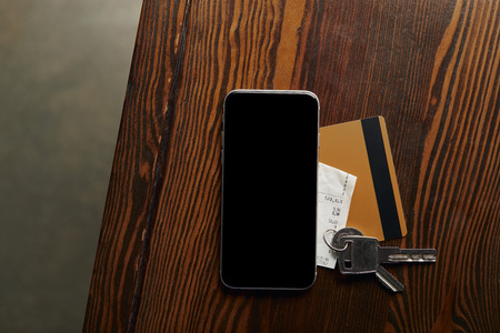 top view of credit card, smartphone, cheque and keys on wooden table Stock Photo - 117896506