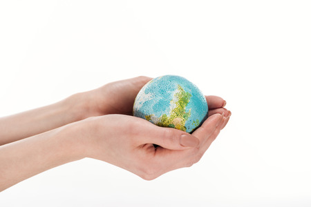 partial view of female hands with globe model isolated on white, global warming concept Stock Photo