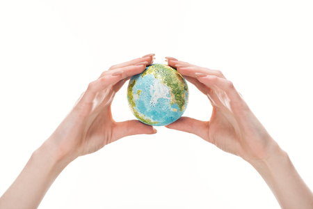 cropped view of female hands with earth model isolated on white, global warming concept