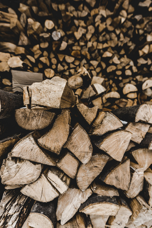 selective focus of  brown textured cut stacked firewood Фото со стока