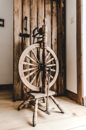retro wooden loom near textured opened door in room Stock Photo
