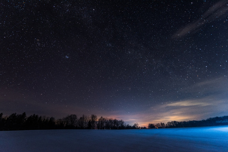 dark sky full of shiny stars in carpathian mountains in winter at night Imagens