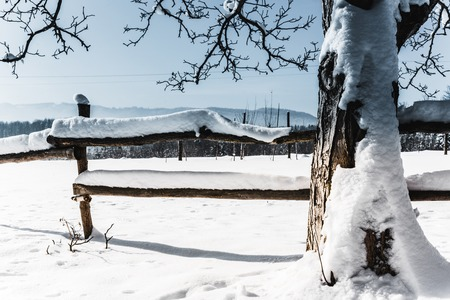 wooden fence covered with snow and icicles in carpathian mountains Stock fotó