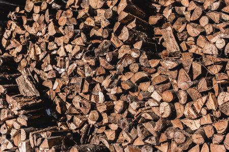 pile of brown cut firewood at sunny day 写真素材