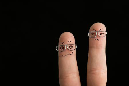 cropped view of frustrated fingers in glasses isolated on black Stock Photo