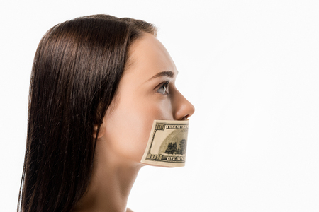 side view of woman with dollar banknote on mouth looking away isolated on white Archivio Fotografico - 118212021