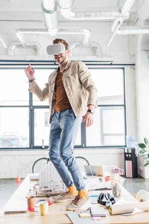 male architect gesturing with hands while having virtual reality experience in loft office