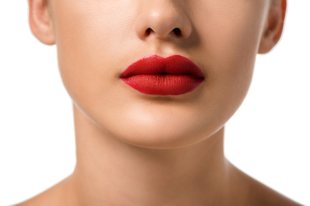 cropped view of girl with red lips isolated on white