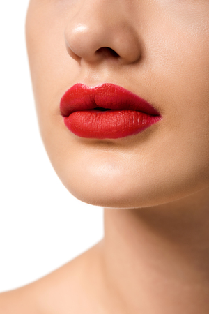 close up view of girl with red lips isolated on white